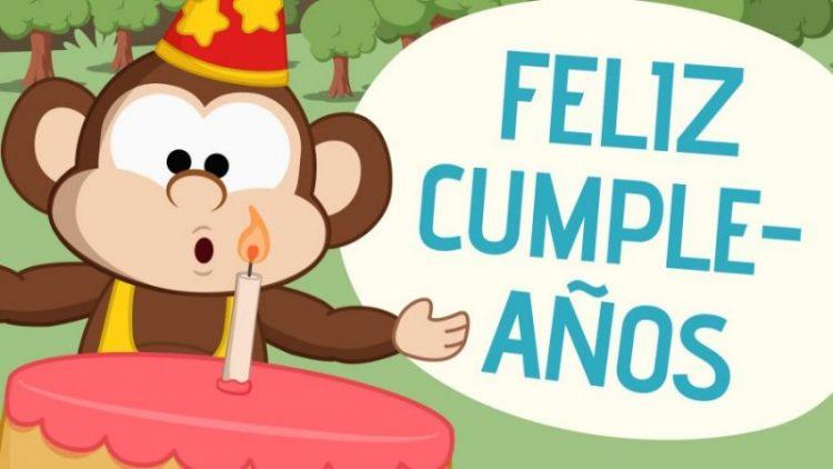 Feliz cumpleaños con un mono y tarta